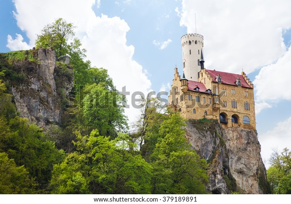 Lichtenstein Castle in Germany on rock cliff over sky