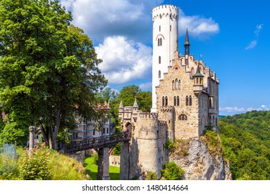 Lichtenstein Castle in summer, Baden-Wurttemberg, Germany. This magic castle is a landmark of Germany. Scenic view of fairytale Lichtenstein Castle on a cliff. Nice mountain landscape of Swabian Alps.