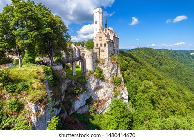 Lichtenstein Castle in summer, Baden-Wurttemberg, Germany. This beautiful castle is a landmark of Germany. Scenic view of magic Lichtenstein Castle on a cliff. Nice mountain landscape of Swabian Alps.