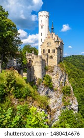 Lichtenstein Castle in summer, Baden-Wurttemberg, Germany. This magic castle is a landmark of Germany. Scenic view of fairytale Lichtenstein Castle on a cliff. Beautiful tourist place in Swabian Alps.