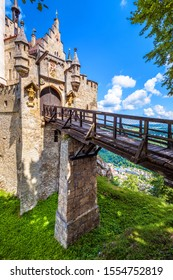 Lichtenstein Castle with wooden bridge, Baden-Wurttemberg, Germany. This fairy tale castle is a landmark of Swabia. Front view of entrance of Lichtenstein Castle in summer. Tourist place in Alps.