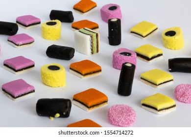 Licorice Allsorts in a orderly pattern. This candy is typical British.