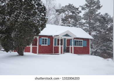 LIDINGOE, STOCKHOLM, SWEDEN, FEBRUARY 2018, a traditional , red painted house ona overcast grey winter day.