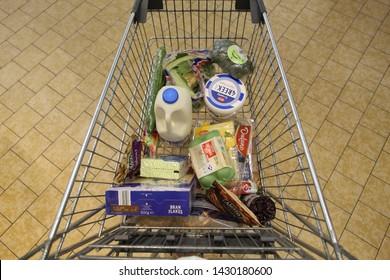 LIDL SUPERMARKET, EDINBURGH, SCOTLAND - 20 June 2019 Lidl Supermarket Trolley Filled with Weekly Groceries