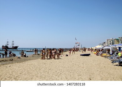 Lido di Jesolo, Italy - August, 2010: Traditional beach at famous summer resort in Italy. Lot of people at the beach. Vacation in Lido di Jesolo, Italy.