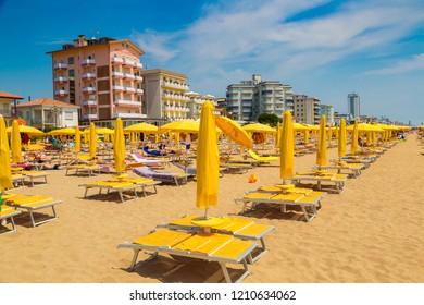 LIDO DI JESOLO, ITALY - JUNE 13, 2016: Umbrellas on the beach of Lido di Jesolo at adriatic Sea in a beautiful summer day, Italy