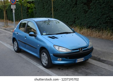 LIDO DI JESOLO, ITALY - JUNE 17, 2013: Peugeot 206 popular French car on the road. A supermini car that is produced by Peugeot from 1998.