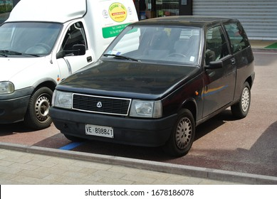LIDO DI JESOLO, ITALY - JUNE 20, 2014: Autobianchi Y10 designer city compact and economy 1990s car manufactured from 1985 to 1995 marketed under the Lancia brand in most export markets as Lancia Y10