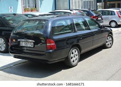 LIDO DI JESOLO, ITALY - JUNE 20, 2014: Ford Mondeo Mk 2 popular 1990s midsize family car on the city street