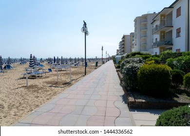 LIDO DI JESOLO, ITALY - May 24, 2019 : Umbrellas on the beach of Lido di Jesolo at adriatic Sea in a beautiful summer day, Italy. On the beach of Lido di Jesolo near Venice, Veneto region, Italy.