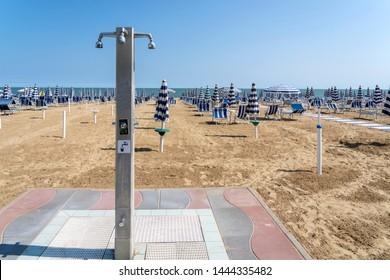 LIDO DI JESOLO, ITALY: Umbrellas on the beach of Lido di Jesolo at adriatic Sea in a beautiful summer day, Italy. On the beach of Lido di Jesolo near Venice, Veneto region, Italy.
