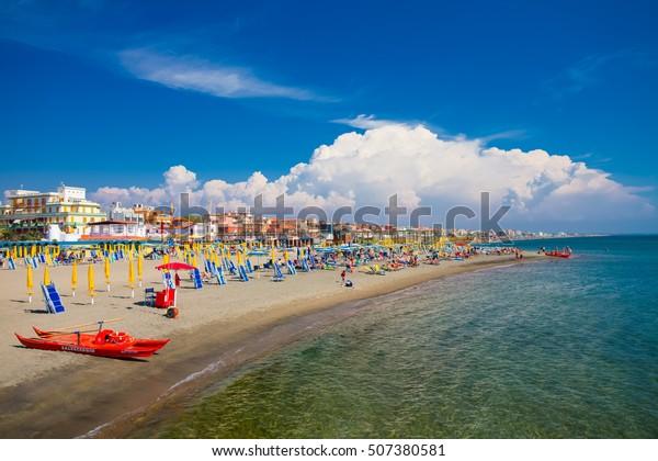 Lido di Ostia, ITALY - September  14, 2016: Swimming and relaxing people on the beautiful beach Lido di Ostia ( Lido di Roma), private beach Battistini, Italy.