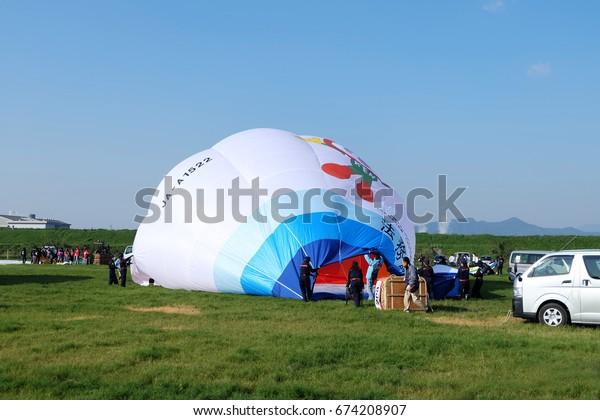 lie down balloon waiting for boarding in Saga International Balloon Fiesta /Saga International Balloon Festival - November 2016,Saga, Japan