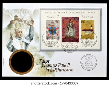 LIECHTENSTEIN - CIRCA 1985 : Cancelled First day cover letter that shows souvenir sheet of postage stamps issued to celebrate State Visit of Pope John Paul II, circa 1985.