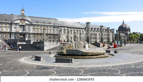 LIEGE, BELGIUM - 3 JULY , 2018 : Modern fountain in the Place Saint-Lambert in the center of Liège, Belgium. City life scene in Liege.