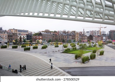 LIEGE, BELGIUM  - 5 OCTOBER 2014: Travellers on the square in front of the Liege-Guillemins railway station, designed by Santiago Calatrava.  Photo taken on October 5 2014 in Liege, Belgium.
