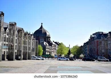 LIEGE, BELGIUM - APRIL 18, 2018: View of old Saint Andrew's Church and buildings in city center, located in Liege, Belgium.