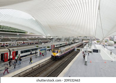 LIEGE, BELGIUM - AUG 5: The Liege-Guillemins railway station on August 5th, 2014 in Belgium. This station is made of steel, glass and white concrete designed by Spanish architect Santiago Calatrava.