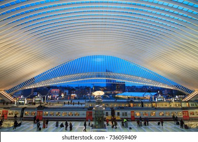 LIEGE, BELGIUM - DECEMBER 12, 2014: Beautiful interior view of the modern architecture railway station Liege-Guillemins with travellers on the platforms in Liege, Belgium, on December 12, 2014