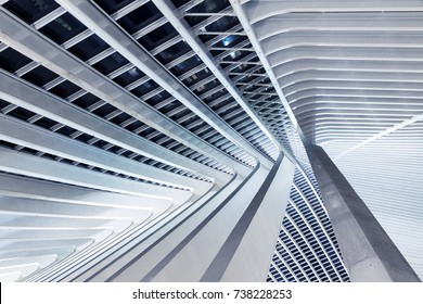LIEGE, BELGIUM - DECEMBER 12, 2014: Beautiful abstract view of the interior of the modern architecture railway station Liege-Guillemins with steel shapes and lines in Belgium on December 12, 2014