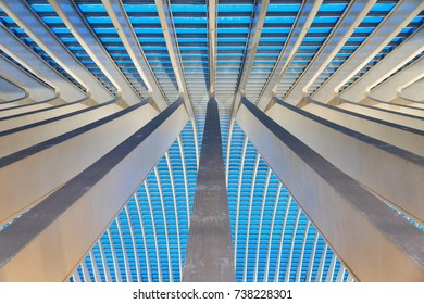 LIEGE, BELGIUM - DECEMBER 12, 2014: Beautiful abstract view of the interior of the modern architecture railway station Liege-Guillemins in the blue hour in Belgium on December 12, 2014