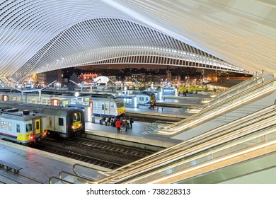 LIEGE, BELGIUM - DECEMBER 12, 2014: Beautiful interior view of the modern architecture railway station Liege-Guillemins with travellers on the platform in Belgium on December 12, 2014
