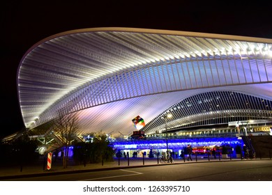 LIEGE, BELGIUM - December 19, 2018: Liege-Guillemins railway station at night, is the main station of the city of Liege and is one of the 3 stations of Belgian on the high-speed rail network.
