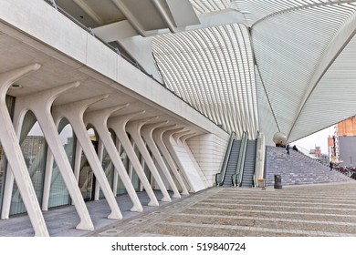 LIEGE, BELGIUM - December 2014: Travellers on the steps in front of the Liege-Guillemins railway station, designed by Santiago Calatrava.