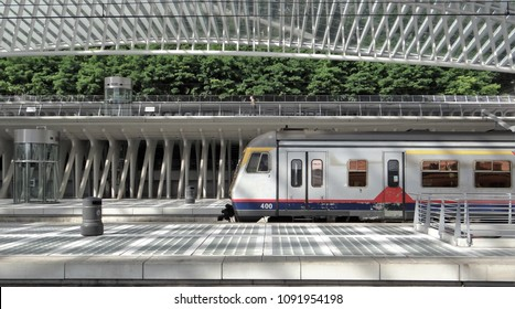 Liege / Belgium - July 9 2016: A NMBS train arrives at the light and modern station Liege-Guillemins or Luik Guillemins.