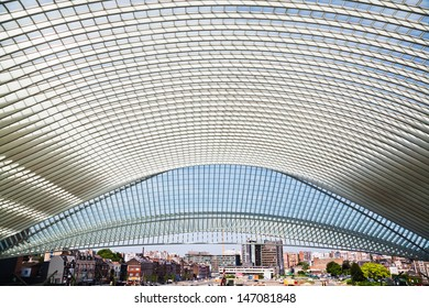 LIEGE, BELGIUM - JUNE 2013: view of the Guillemins station with the cityscape of Liege on June 2013 in Liege, Belgium. The Guillemins station was built by the famous architect Santiago Calatrava.