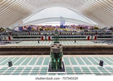 LIEGE, BELGIUM - November 2017: Moving train seen at Liege-Guillemins railway station designed by famous architect Santiago Calatrava
