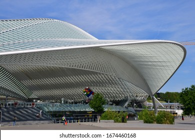 Liege, Belgium-August 2019: The train station of Liege, made of steel, glass and white concrete. It includes a monumental arch, 160 metres long and 32 meters high by architect Calatrava