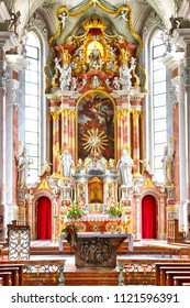 LIENZ / AUSTRIA - JUNE 2018: Beautiful rich red altar decoration at the roman catholic St. Andra church (Church of St. Andrew) in Lienz, Austria.