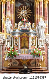 LIENZ / AUSTRIA - JUNE 2018: Beautiful rich red altar decoration at the St. Andra church (Church of St. Andrew) in Lienz, Austria.