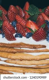 Liepaja, Kurzeme, Latvia - 04.28.2015 Cake, pie with strawberries, blueberries, pepermint on the top.