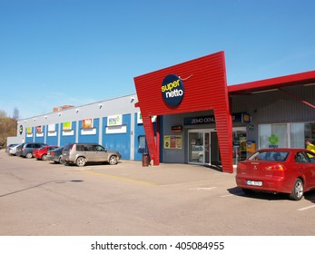 LIEPAJA, LATVIA - APRIL 11, 2016: Entrance of supermarket Super Netto is located on Ganibu street and contains number of shops and pharmacy.