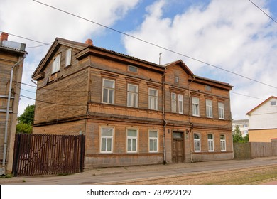 LIEPAJA, LATVIA, AUGUST 4, 2017, Typical wooden house inthe town of Liepaja, Latvia on a sunny summer day with blue sky and fluffy clouds, Liepaja, 4 August 2017