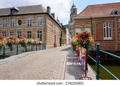 Lier, Belgium - July 11, 2018; The Aragon Bridge is an arch bridge over the Binnennete and connects the eponymous Aragonstraat and Kerkstraat to theSaint Gummarus Church