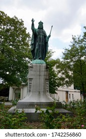 Lier, Belgium - July 11, 2018; The bronze Christ the King statue, on the park next to the St. Gummarus Church. Posted in gratitude for the end of the war.