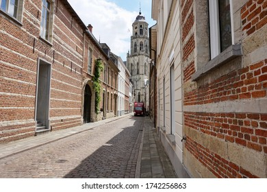 Lier, Belgium - July 11, 2018; The old 'Kerkstraat' leads to the munumental high tower of the sain Gummarus church