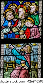 LIER, BELGIUM - MAY 16, 2015: Stained Glass window in St Gummarus Church in Lier, Belgium, depicting Jesus and the Apostles at the Last Supper, with the traitor Judas Iscariot in front.