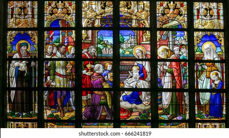LIER, BELGIUM - MAY 16, 2015: Stained Glass window in St Gummarus Church in Lier, Belgium, depicting an Epiphany Scene, with the Visit of the Three Magi to Bethlehem