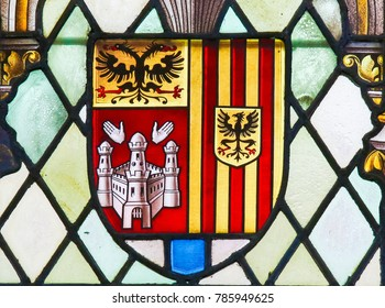 LIER, BELGIUM - MAY 16, 2015: Stained Glass in St Gummarus Church in Lier,  depicting the Coat of Arms of the Province of Antwerp, consisting of the shields of Antwerp, Mechelen and Turnhout.