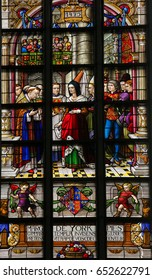 LIER, BELGIUM - MAY 16, 2016: Stained Glass in St Gummarus Church in Lier, depicting Margaret of York (1446 - 1503), wife of Charles the Bold, receiving a description of the life of St Gummarus.