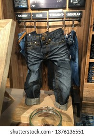 Lier, Norway - April 20th 2019: Tiny pants decoration in a jeans store. Shop exhibition