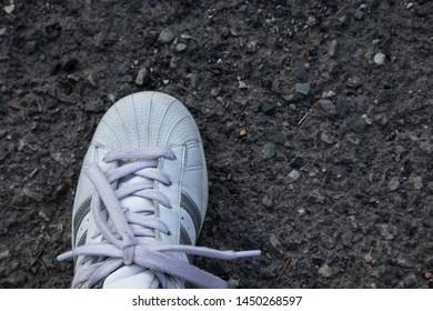 Lier, Norway - July 12th 2019: White Adidas originals superstar. Silver stripes.
