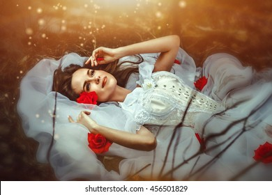 lies a sleeping beauty in a white dress