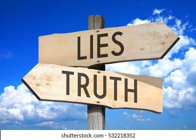 Lies, truth - wooden signpost