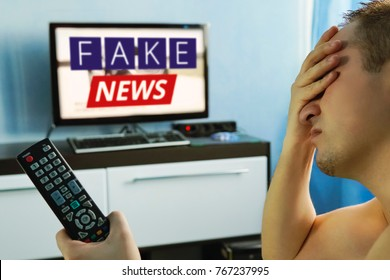 lies of tv propaganda mainstream media disinformation, A fake news report. viewer is watching TV and doesn't believe in fake news. man closes his eyes not to watch the lies on TV