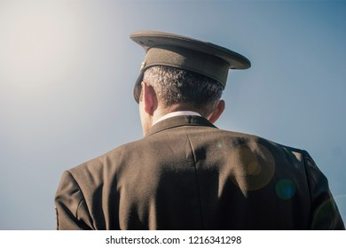 Lieutenant colonel looking at sky